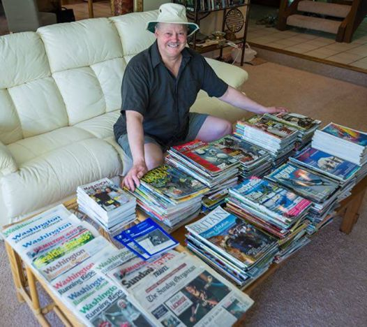 Travel magazine lists are needed to get your travel stories published. Here's my photo with many mags where I've been published.