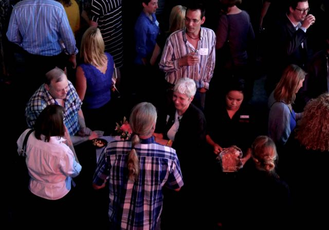 Travel writers networking at social event.