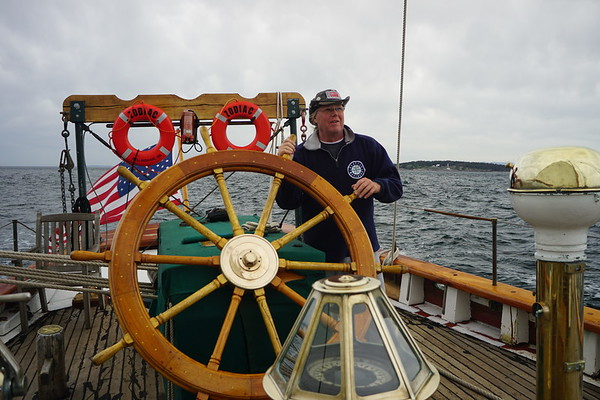 Jed Vaughn at helm of Schooner Zodiac