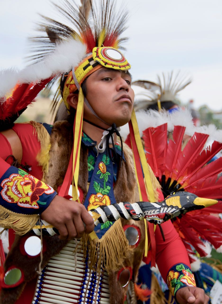 native american dancer in full costume