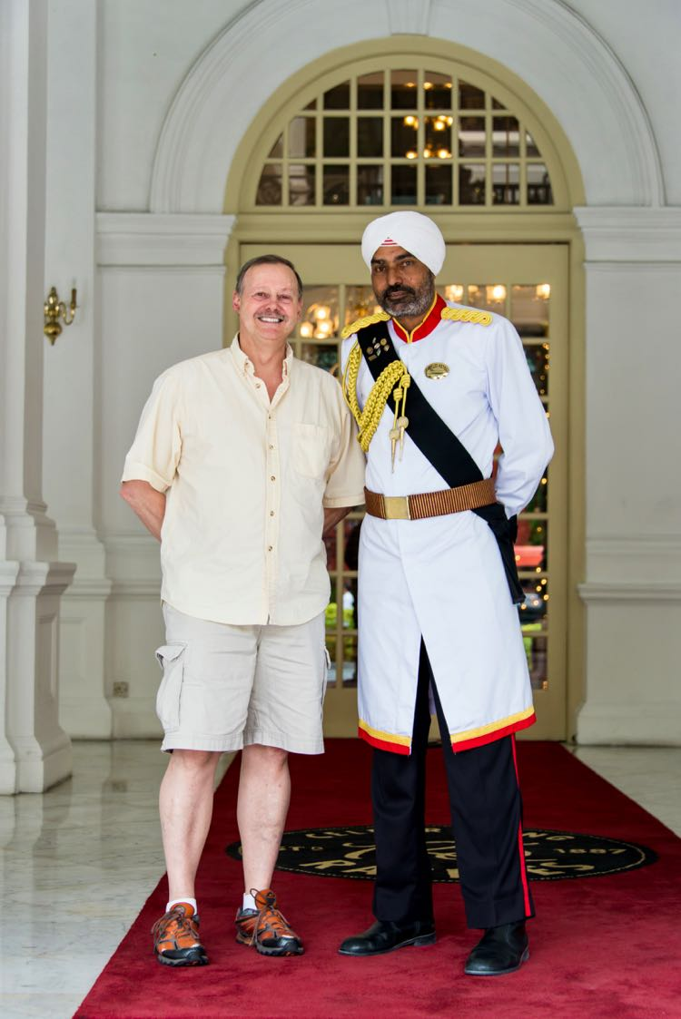Roy Stevenson poses with Sikh doorman at Raffles Hotel, Singapore