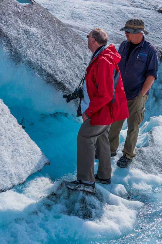 walking on a glacier in Alaska with our helicopter pilot
