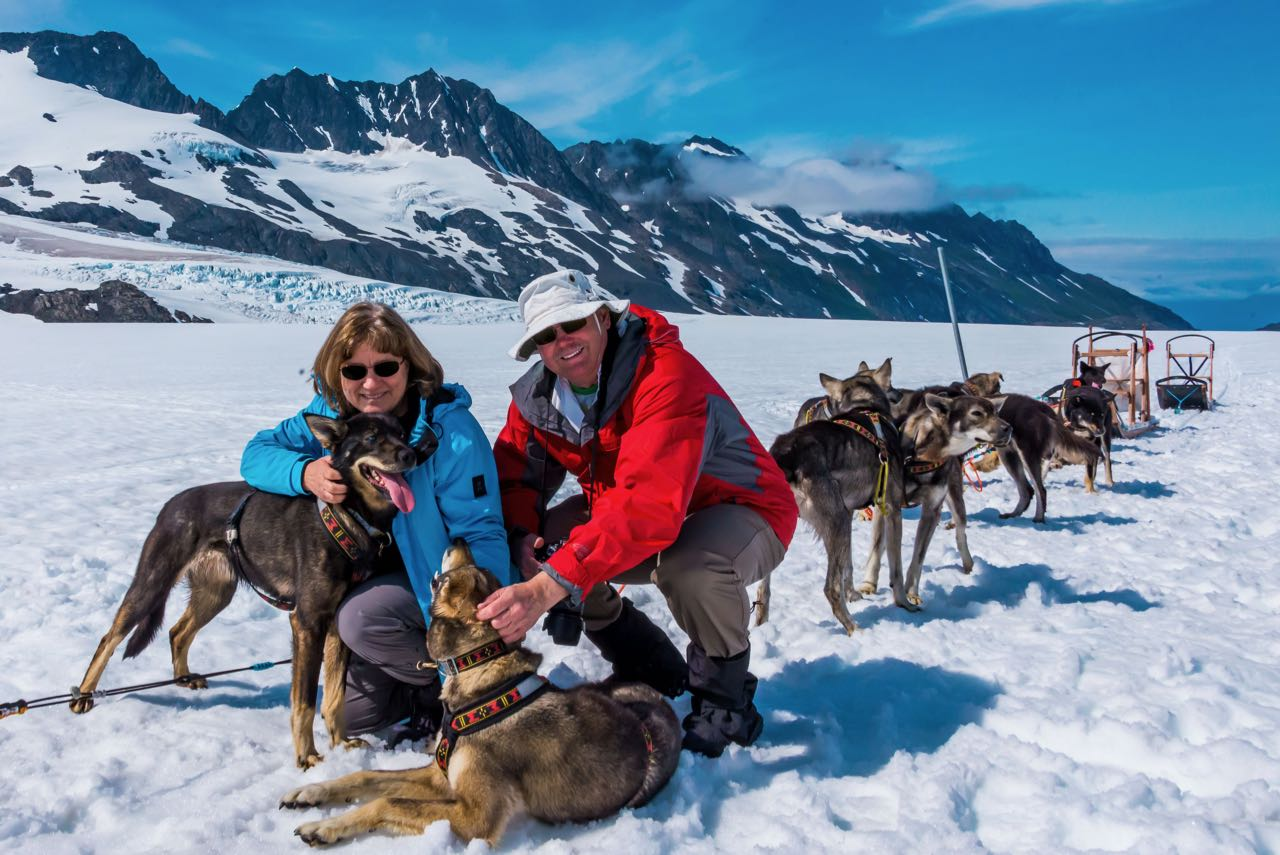Playing with dogs at dog-sled camp in Alaska