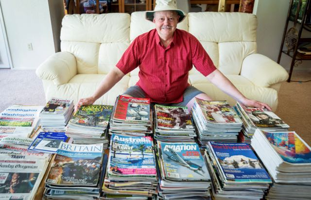 Roy Stevenson with magazines and newspapers that published his articles.