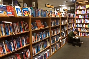 shelf full of guidebooks at bookstore in Arizona