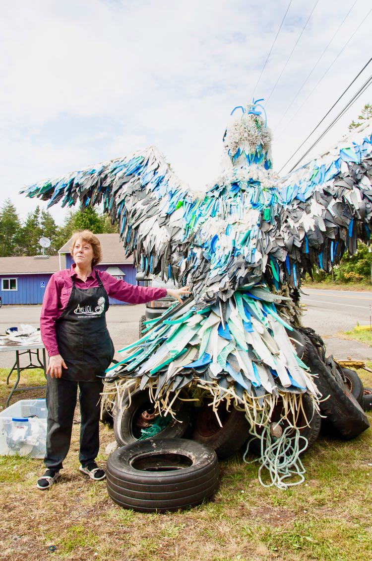 Angela Pozzi and her eagle made from ocean trash