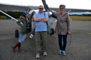 Standing with 2 other travel writers in the Yukon
